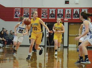 """<p class=""""p1""""><strong>Maplewood's Maggie Hunter (33) dribbles the basketball up the court during Saturday's District 10 2A Consolation Game against Cambridge Springs, at Meadville High School.</strong></p>"""