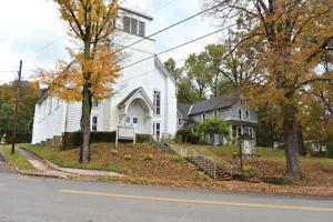 <p>Fidelia Hall, which was once St. Paul's German Reform Church, will be sold in an auction today, alongside an accompanying home on the property. The hall was most recently the home of Justin Hoenke, who was the executive director of Benson Memorial Library until his resignation last month, and his family.</p>