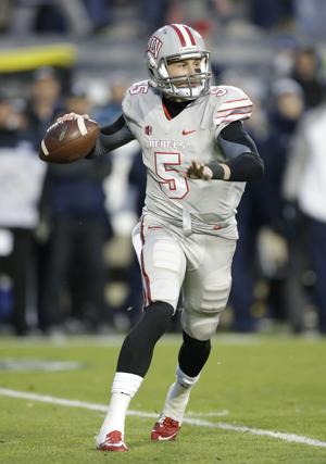 UNLV quarterback Blake Decker (5) passes the ball in the first quarter during an NCAA college football game against Brigham Young Saturday, Nov. 15, 2014, in Provo, Utah. (AP Photo/Rick Bowmer)
