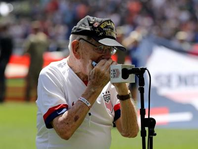 """WWII veteran """"Harmonica Pete"""" DuPre performs the national anthem before the match between the the United States and Mexico at Red Bull Arena on May 26, 2019 in Harrison, New Jersey."""