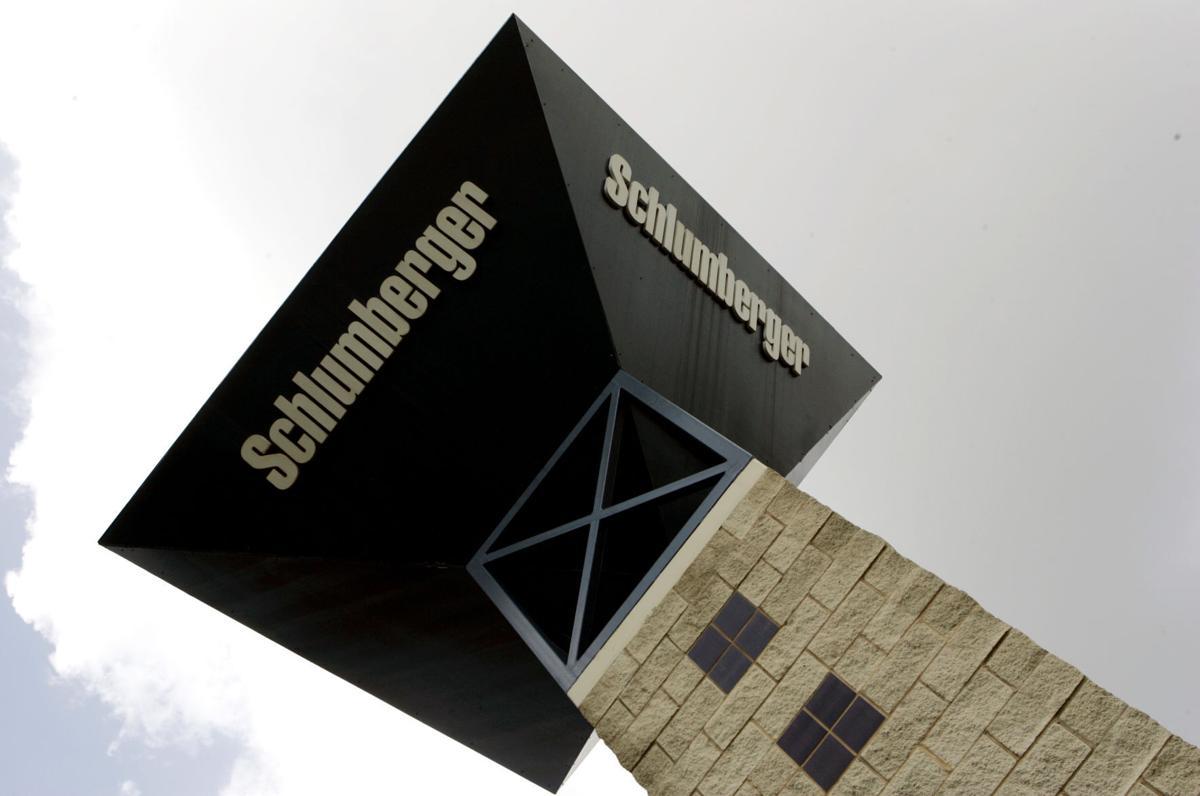 Earns Schlumberger