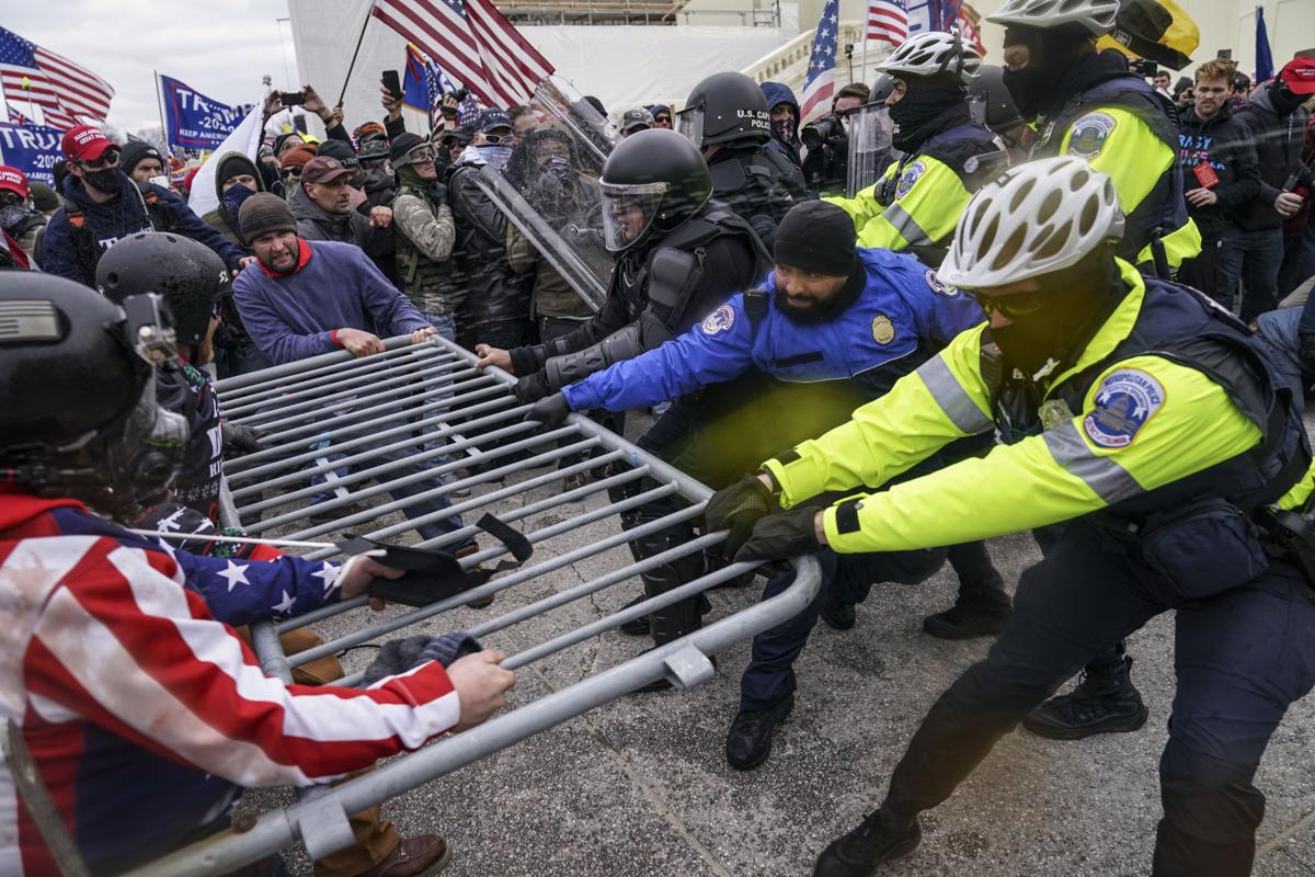 Mob tries to break through police barrier