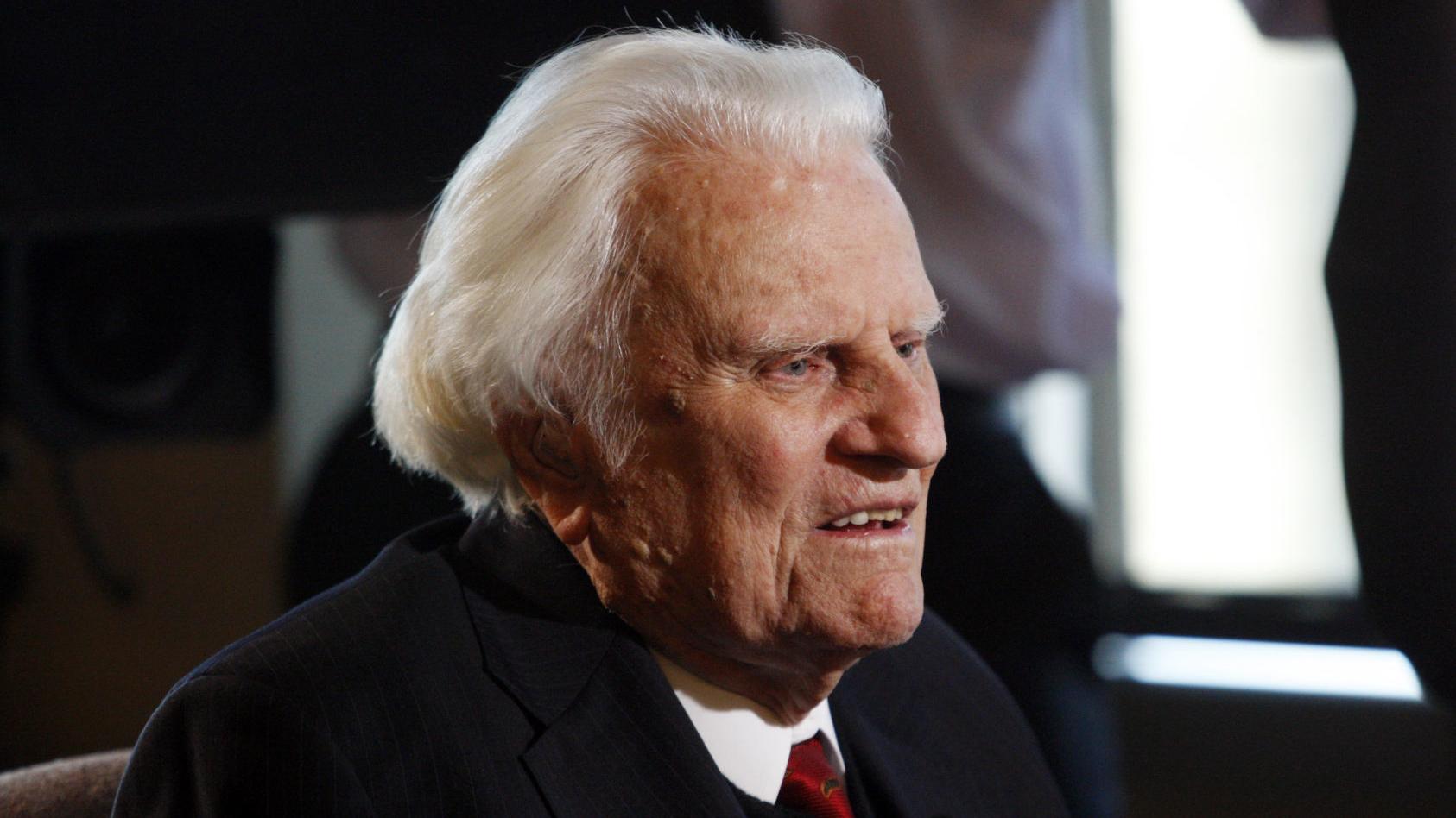 Famed evangelist Billy Graham dies at age 99, spokesman says