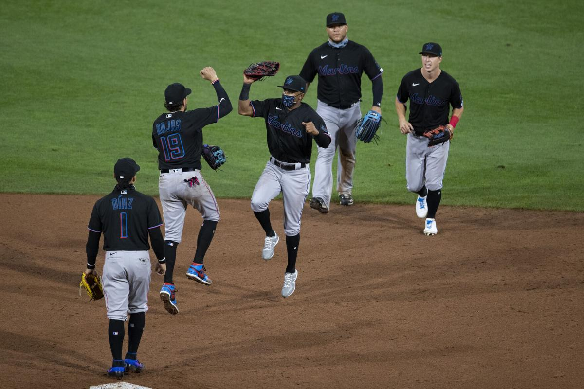 The Miami Marlins celebrate a 5-2 win on Opening Day against the Philadelphia Phillies at Citizens Bank Park on July 24, 2020, in Philadelphia.