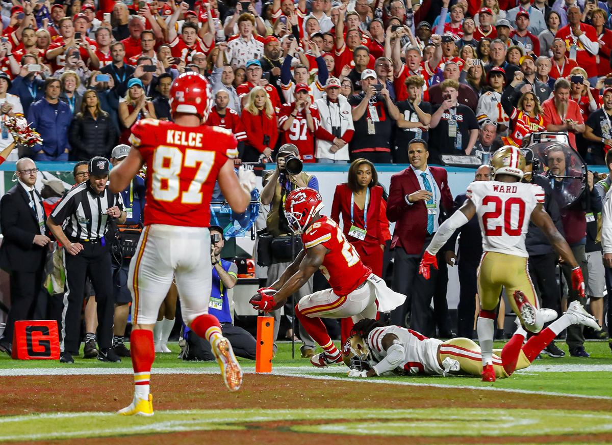 Kansas City Chiefs running back Damien Williams (26) scores a touchdown on a 5-yard pass reception against the San Francisco 49ers during the fourth quarter of Super Bowl LIV at Hard Rock Stadium in Miami Gardens, Fla., on Sunday, Feb. 2, 2020. The Chiefs won, 31-20.