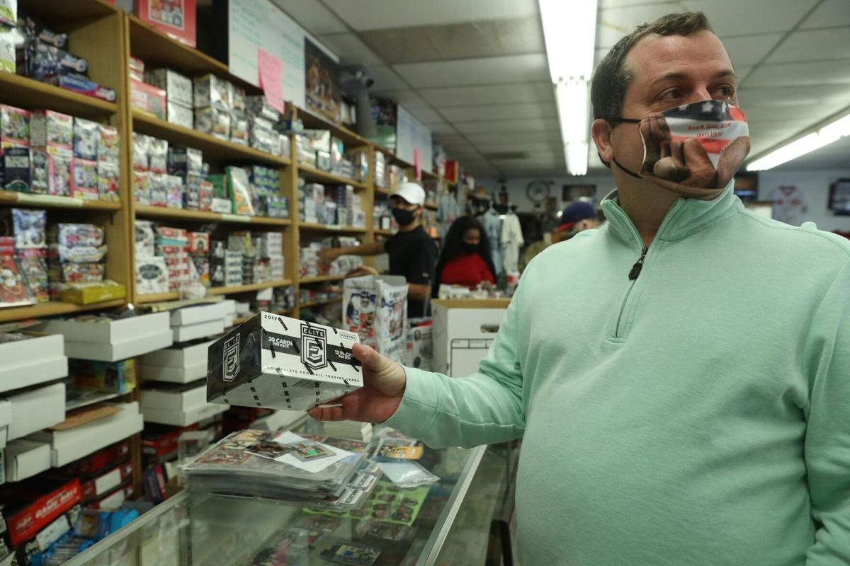 Trading card collector David Spada, of Mundelein, holds a box of football cards he purchased at Jim and Steve's Sportscards, Feb. 10, 2021, in Waukegan.