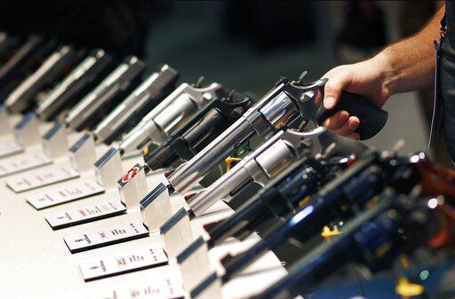 Gun industry gathers amid slumping sales, rising tensions