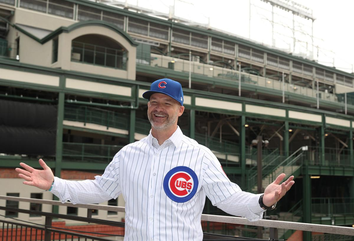 New Cubs manager David Ross poses for photographs at the American Airlines Conference Center next to Wrigley Field.