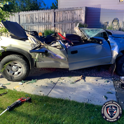 Driver hits house