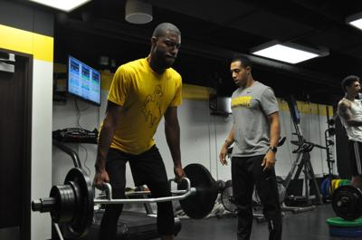 Wyoming men s basketball strength and conditioning coach Marcus Edwards  trains senior Jordan Naughton during summer conditioning. a5e4c5c5bde