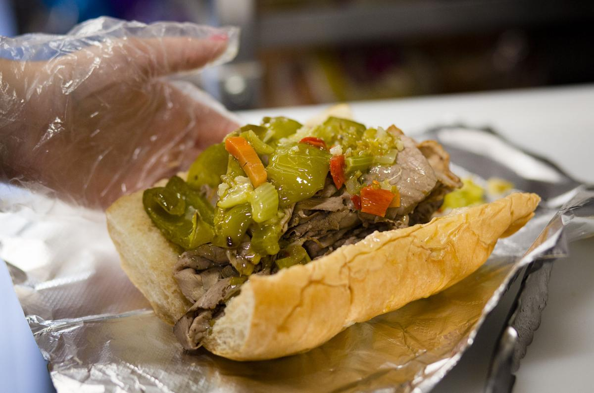 New downtown business pairs deli with Wyoming Cowboys merchandise