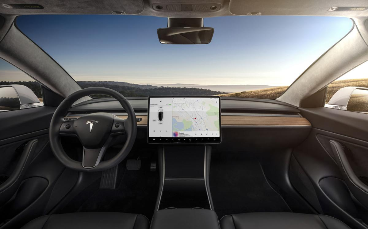 Behind the Wheel Tesla