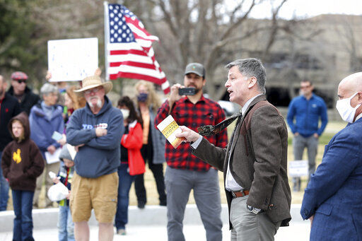 Wyoming governor engages with COVID-19 protesters at Capitol