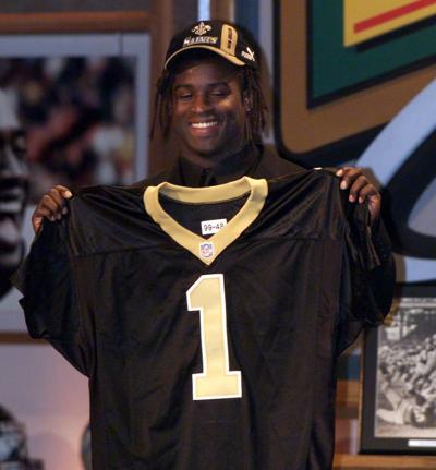 Heisman Trophy winner Ricky Williams, running back from Texas, shows off his New Orleans Saints jersey after being picked fifth in the NFL draft Saturday, April 17, 1999.