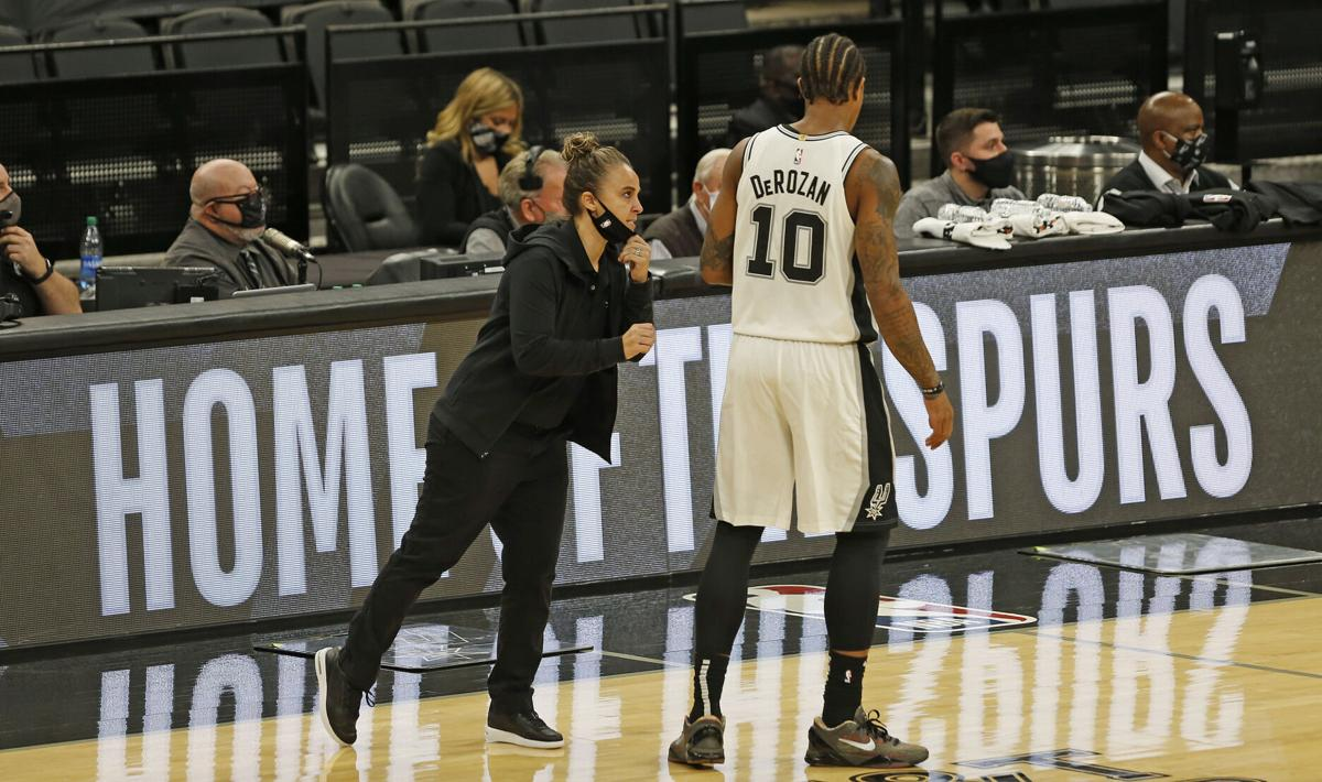 Becky Hammon, assistant coach of the San Antonio Spurs, talks with DeMar DeRozan at AT&T Center on December 30, 2020 in San Antonio, Texas.