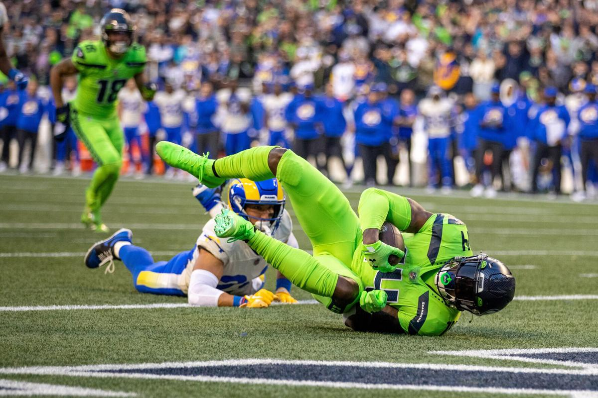 Seattle Seahawks wide receiver DK Metcalf rolls into the end zone with a 19- yard touchdown reception during the second quarter on Thursday, Oct. 7, 2021, at Lumen Field in Seattle.