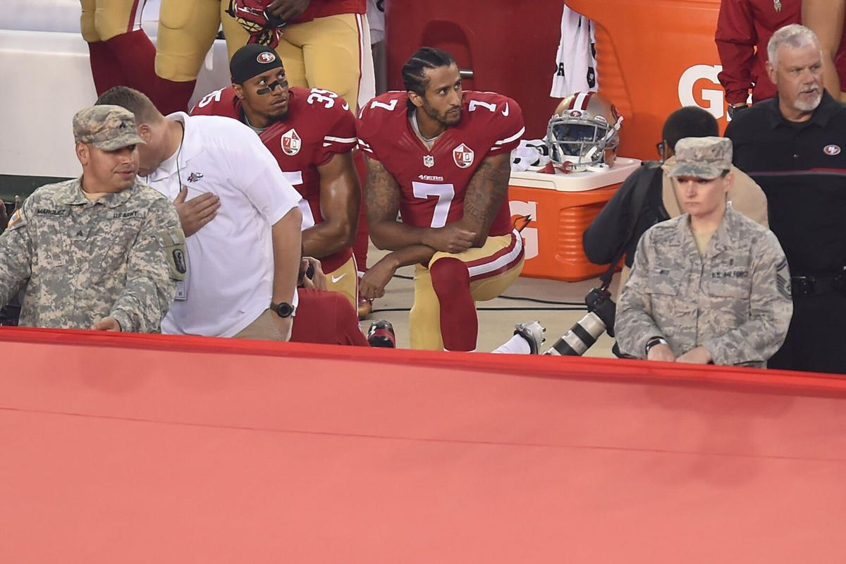 San Francisco 49ers quarterback Colin Kaepernick (7) and Eric Reid (35) kneel down during the playing of the national anthem before their NFL game on Monday, Sept. 12, 2016 at Levi's Stadium in Santa Clara, Calif.