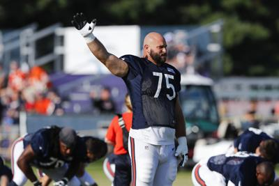 Chicago Bears offensive guard Kyle Long stretches at training camp in Bourbonnais, Ill. on Aug. 2, 2019. Long announced Sunday on Twitter that he has retired.