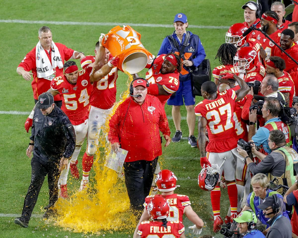 Kansas City Chiefs head coach Andy Reid reacts as players shower him on the sidelines at the conclusion of a 31-20 win against the San Francisco 49ers in Super Bowl LIV at Hard Rock Stadium in Miami Gardens, Fla., on Sunday, Feb. 2, 2020.