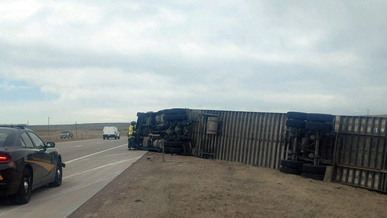Nearly a dozen vehicles blew over Tuesday on Wyoming highways