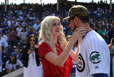 Julianna Zobrist greets her husband Ben Zobrist after she sang the national anthem on Memorial Day at Wrigley Field on May 30, 2016 in Chicago.