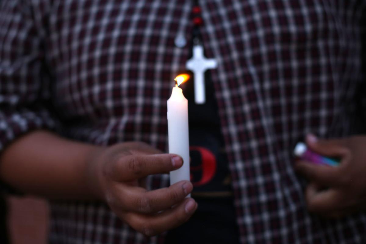 Vigil for man killed in police shooting