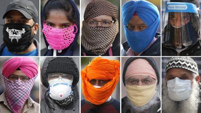 Virus Outbreak Britain Face Masks