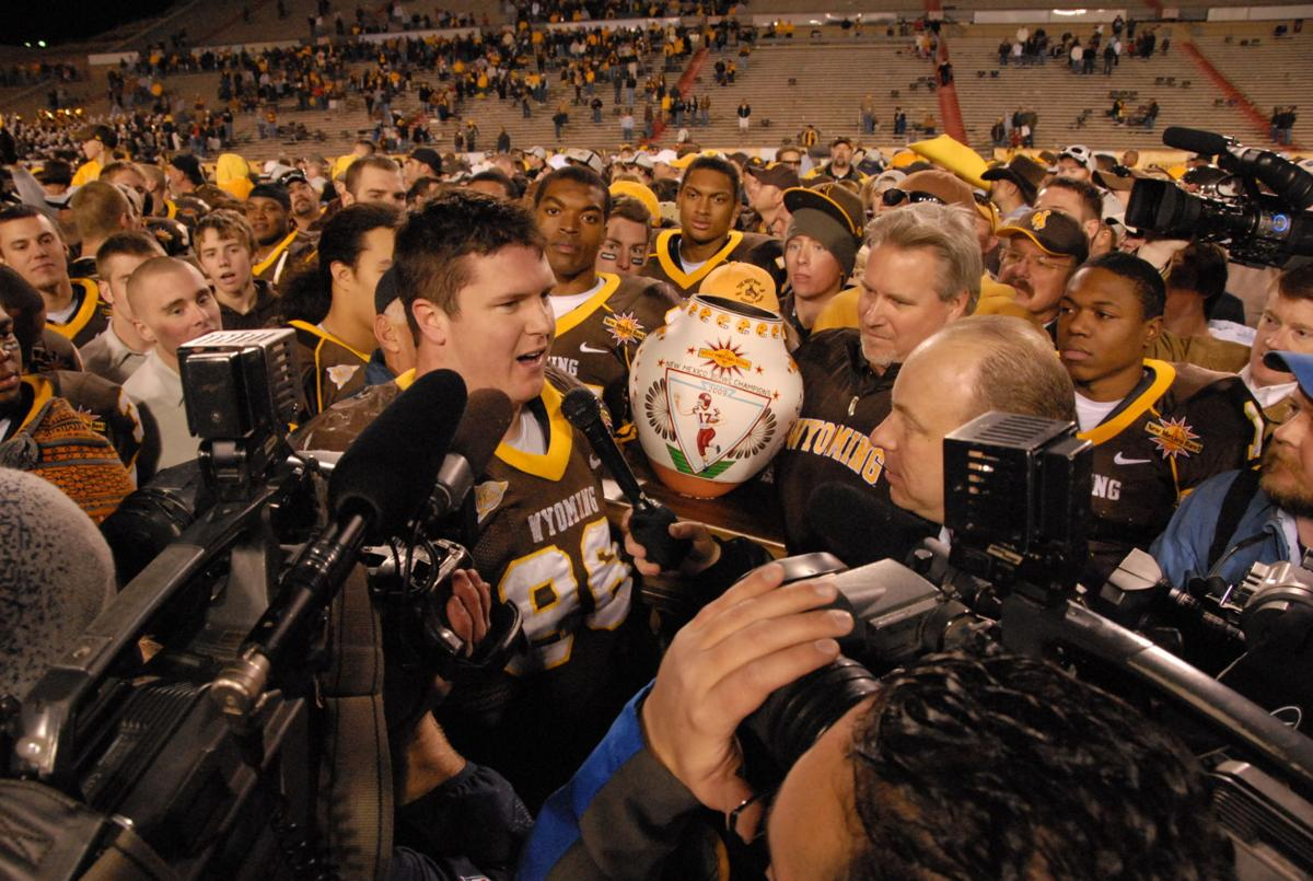Mitch Unrein Accepting Defensive Player of the Game Award DS.JPG