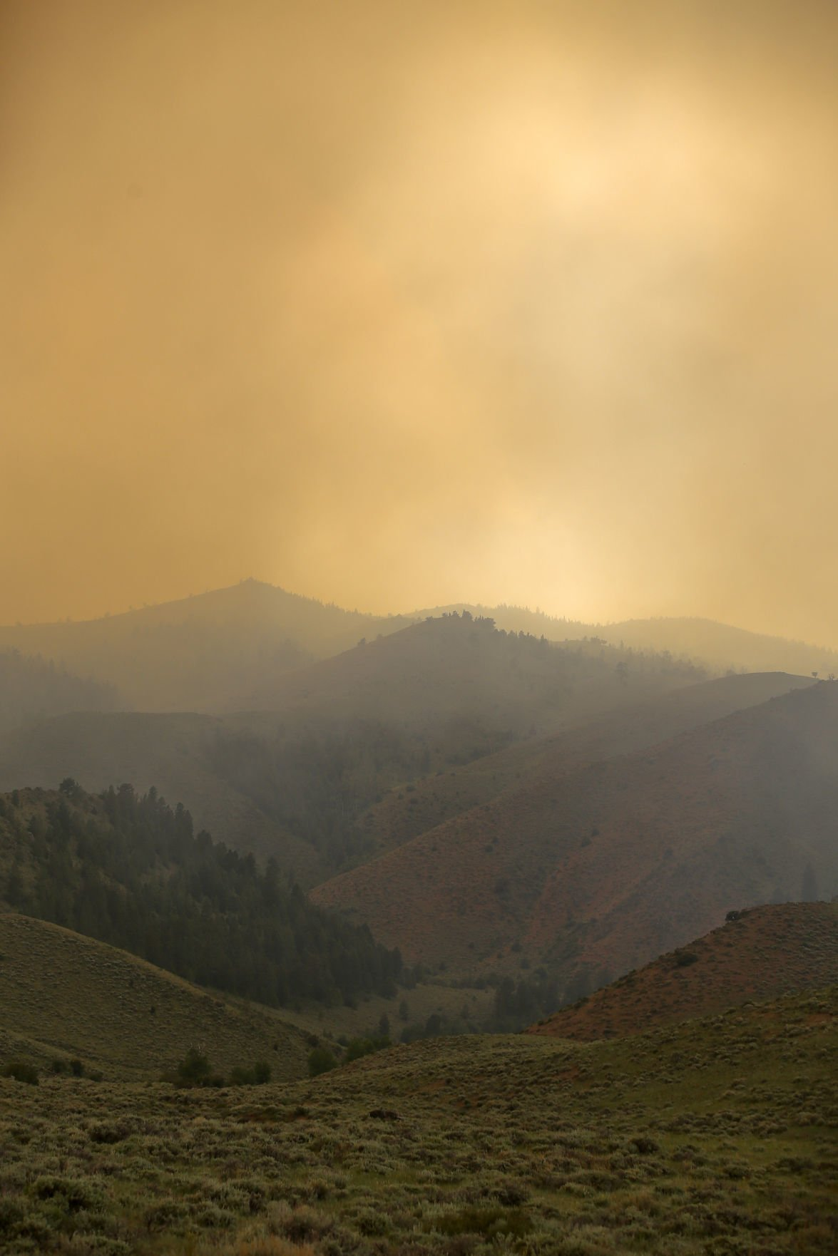 Wyoming wildfire doubles in size