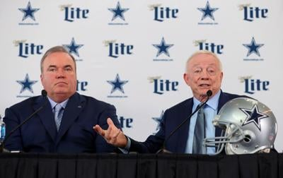 Dallas Cowboys head coach Mike McCarthy, left, and owner Jerry Jones talk with the media during a news conference at the Ford Center at The Star in Frisco, Texas, on Wednesday, Jan. 8, 2020 .