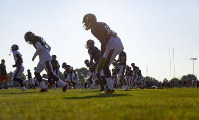 The Chicago Bears warm up during training camp on July 28, 2019.
