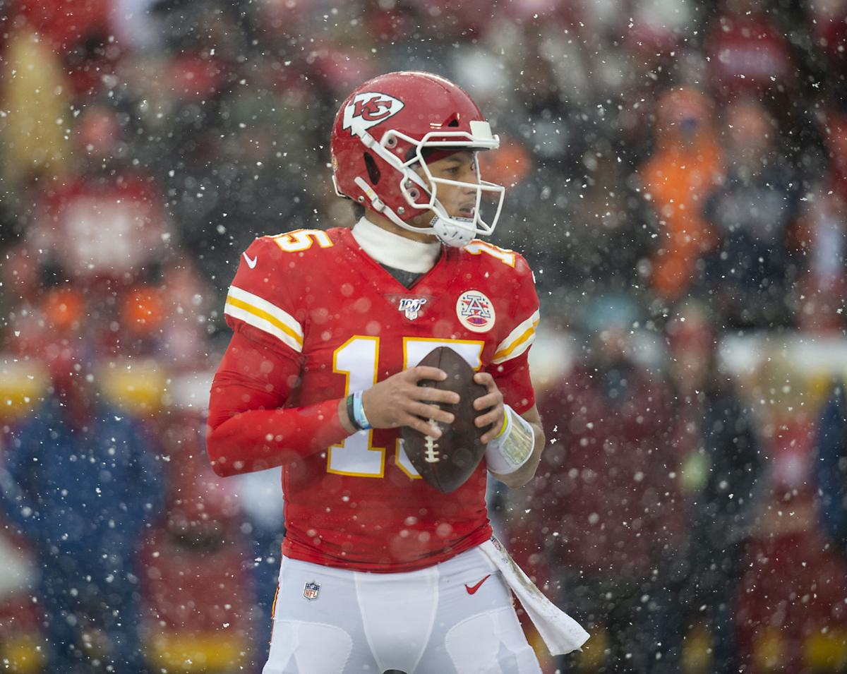 Kansas City Chiefs quarterback Patrick Mahomes looks for a receiver downfield in the second quarter while playing the Denver Broncos Sunday, Dec. 15, 2019 at Arrowhead Stadium in Kansas City, Mo.