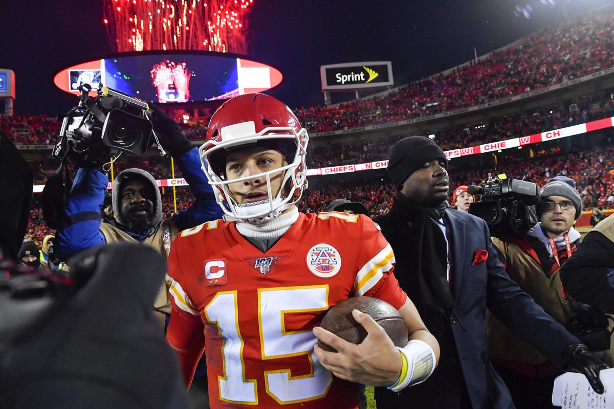 Kansas City Chiefs quarterback Patrick Mahomes carries the game ball off the field after the Chiefs defeated the Houston Texans 51-31 Sunday, Jan. 12, 2020, at Arrowhead Stadium in Kansas City, Mo.