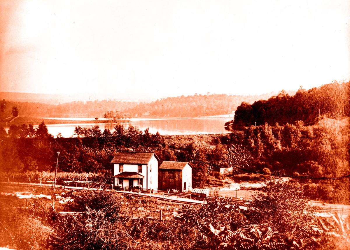 House w dam in background.JPG