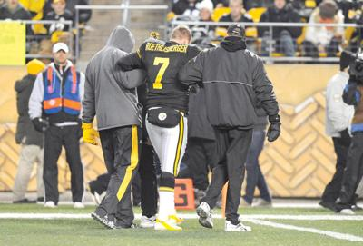 ff137e5d06d Pittsburgh Steelers quarterback Ben Roethlisberger (7) is helped up after  being injured in the second quarter of the NFL football game against the  Cleveland ...