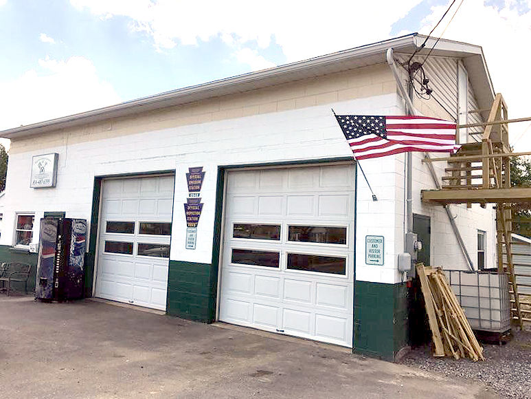 Father son garage opens in sidman news tribdem