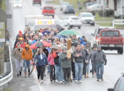 Area Christians gather for Good Friday cross walks