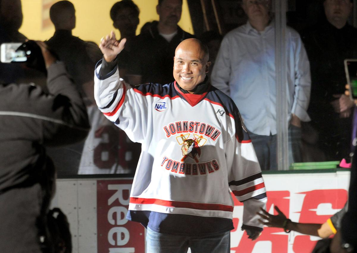 4d7756c5833 Former Pittsburgh Steelers Pro Bowler and Super Bowl XL MVP Hines Ward  acknowledges the crowd as he steps on the ice to drop the first puck before  the ...