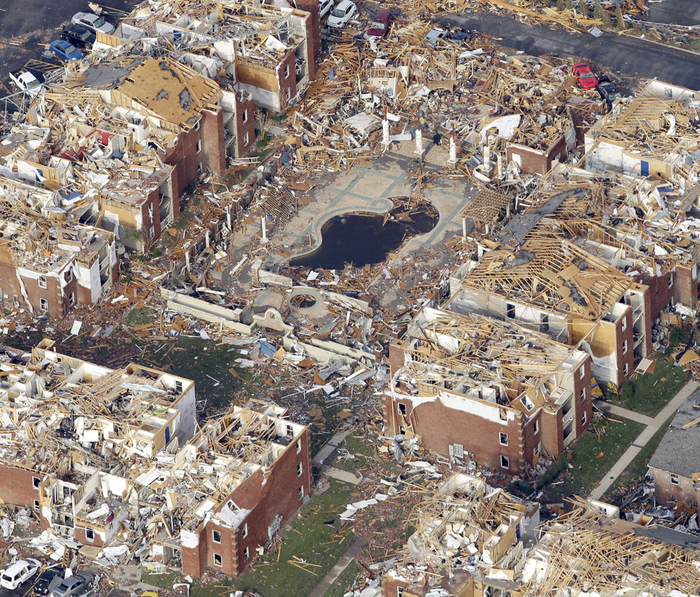 Town ripped by tornado braces for more