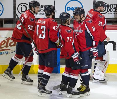 Washington Capitals right wing T.J. Oshie (77) is congratulated by teammate  Alex Ovechkin (8) as they celebrate Oshie s overtime goal against the  Pittsburgh ... 7a06daed49ea