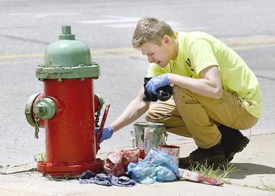 Cameron Bunn painting hydrants