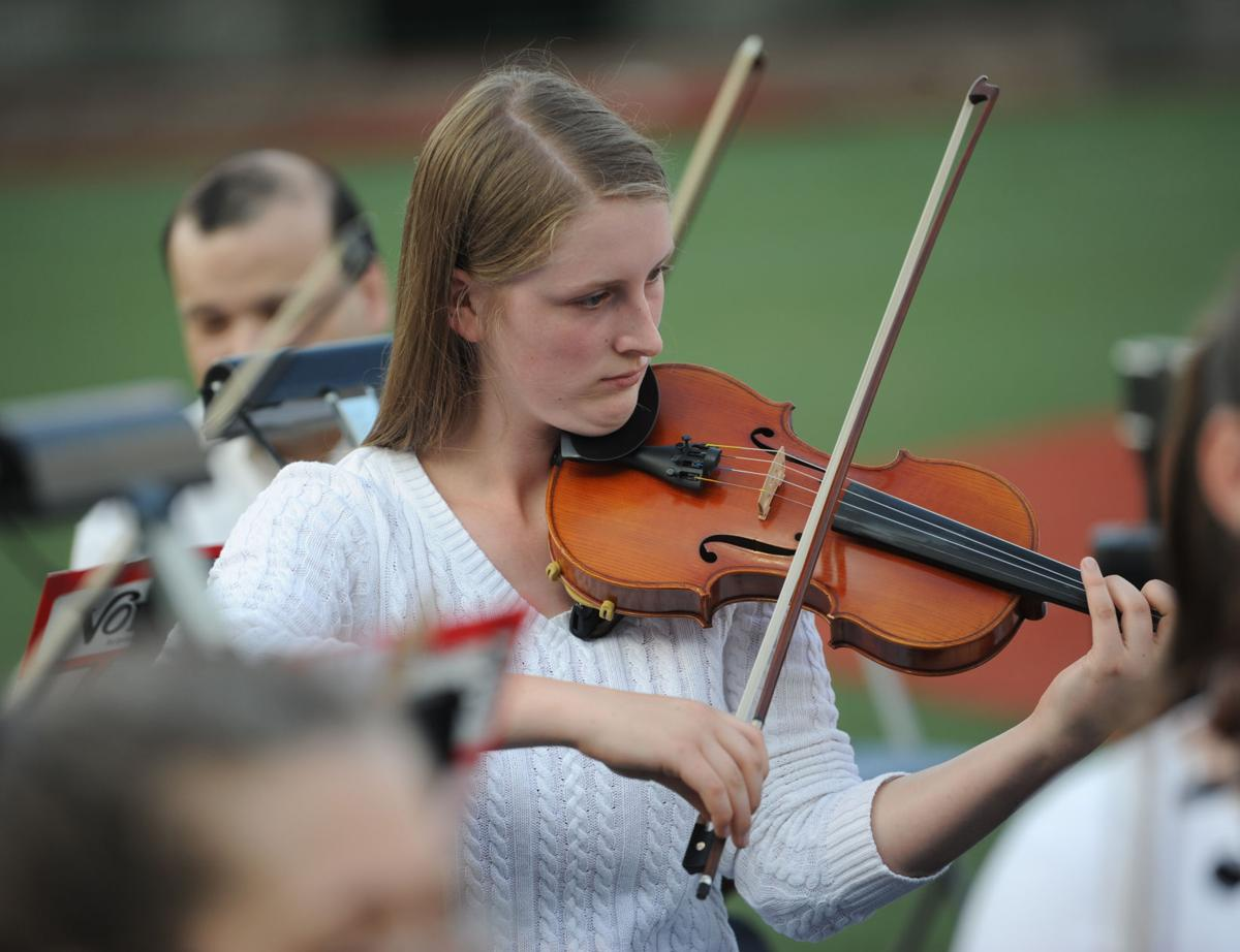 Violinist zelie eger performs with the johnstown symphony orchestra