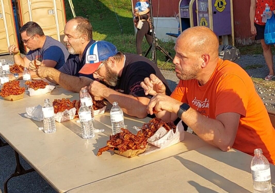 Bacon eating contestants
