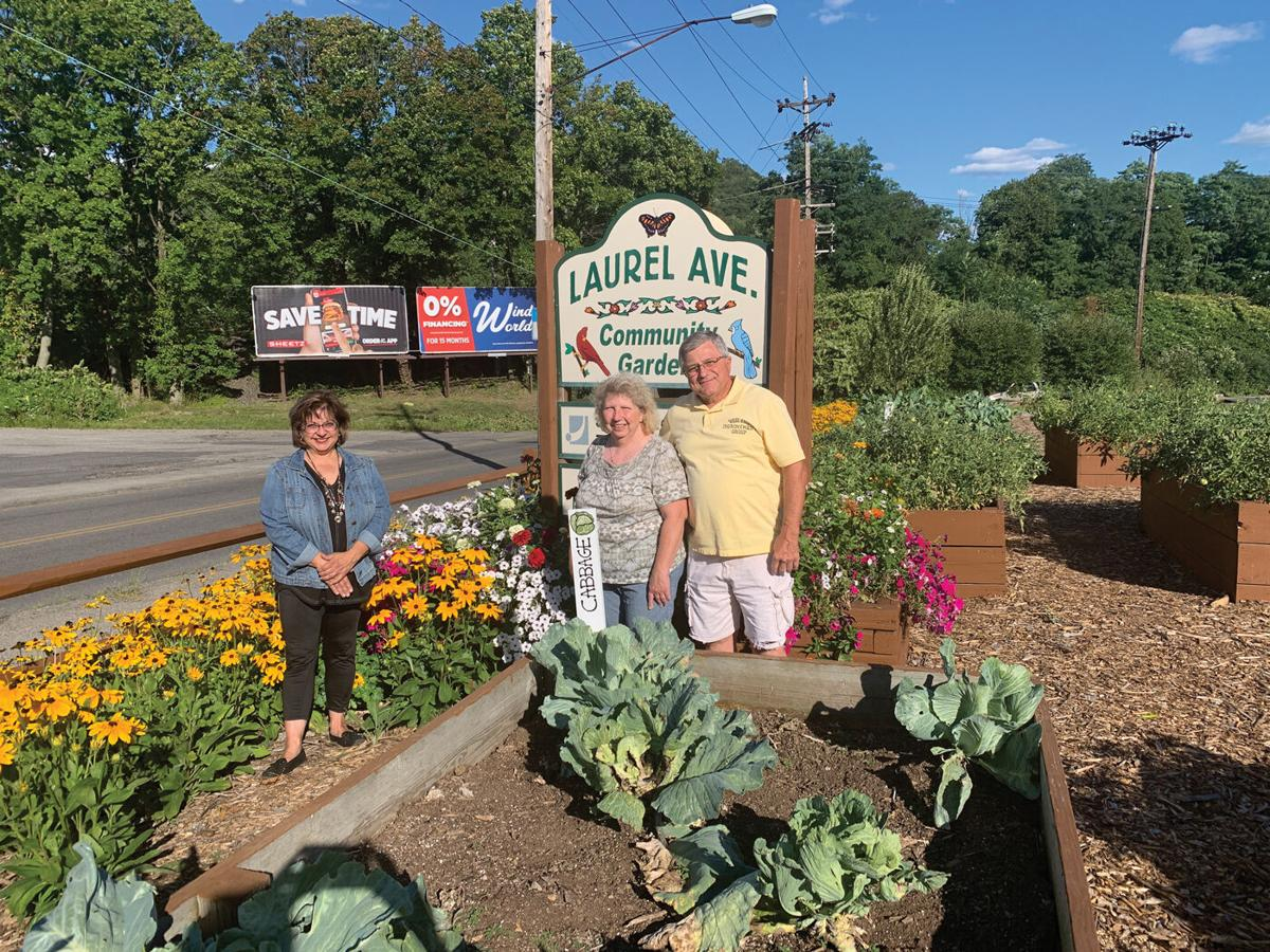 Marie-Mock-with-Rose-and-John-at-West-End-community-garden.jpg