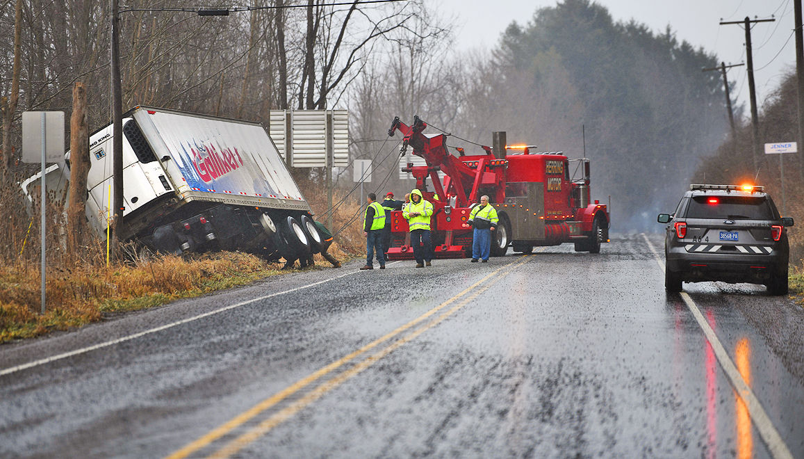Truck slides off road in Jennerstown