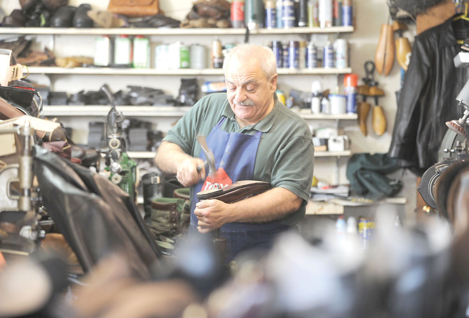 Shoe repairman helps customers' soles