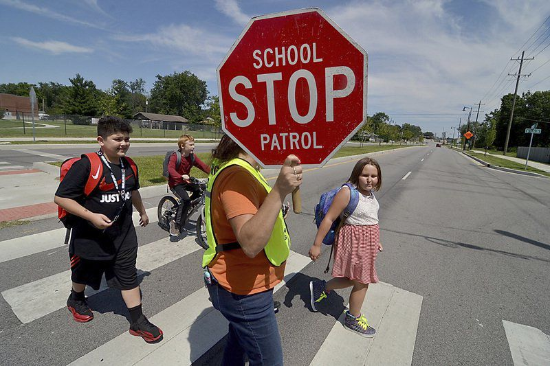 As kids return, crossing guards take up job they love