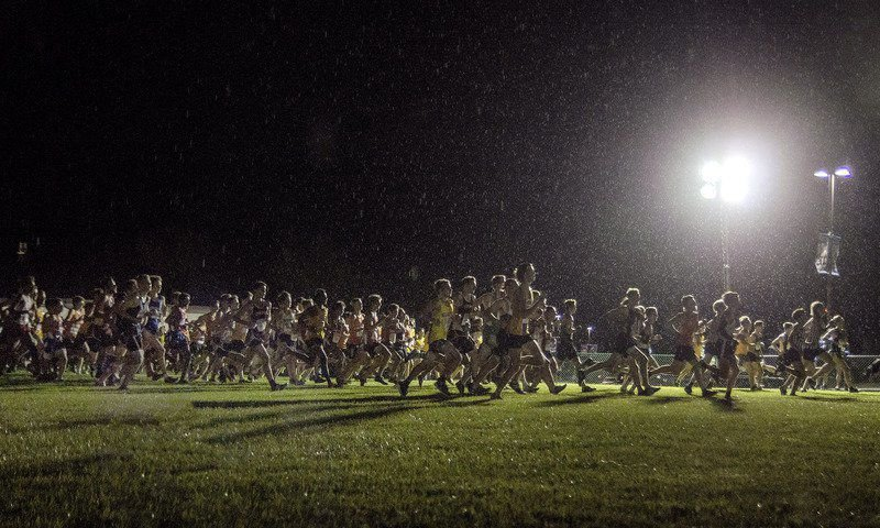 Cross country athletes enjoy running with lights on