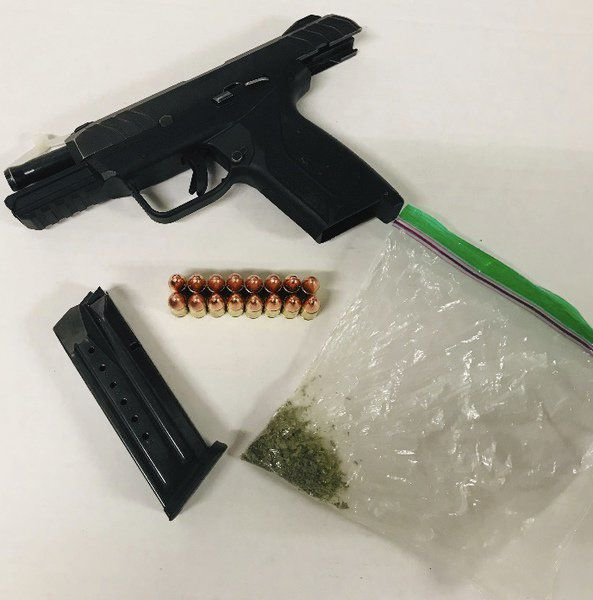 ISP says traffic stop leads to gun, pot arrest