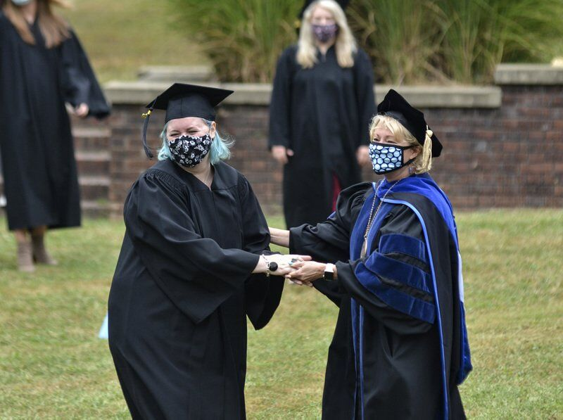 Worth the wait: 60 SMWC students get Woods Ring in ceremony delayed six months because of COVID-19